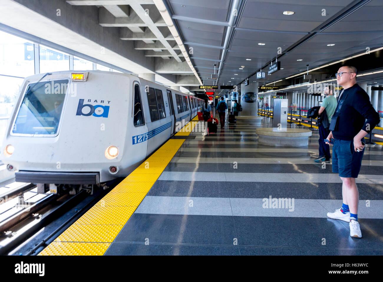 San Francisco, CA, USA, Chinese Man standing alone in empty train BART Subway Metro Station Platform at Airport - Stock Image