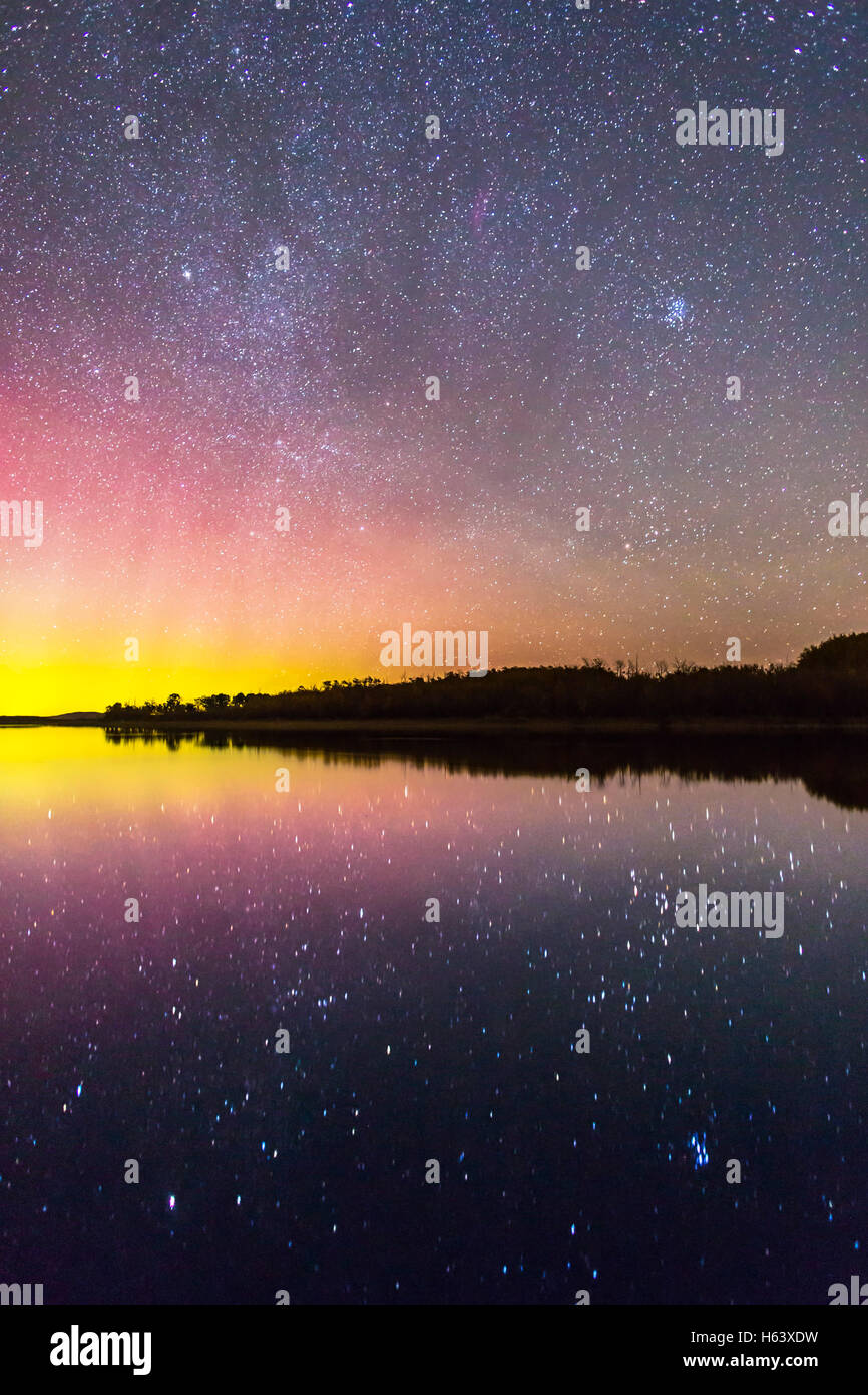 The rising autumn stars and constellations over and reflected in the lake at Police Outpost Provincial Park, in - Stock Image