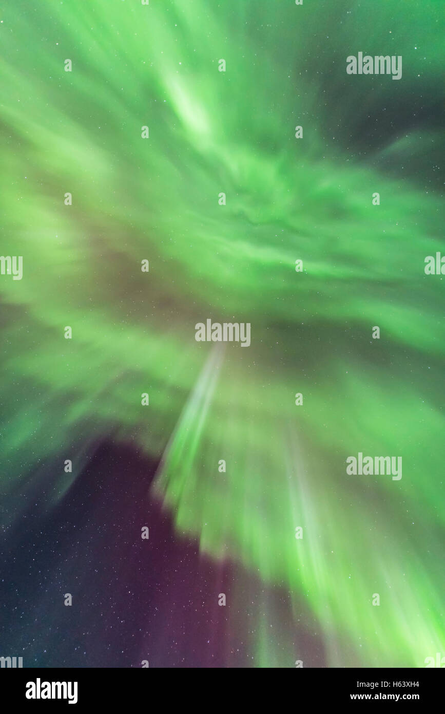 Looking up at multiple converging curtains of Northern Lights at the zenith, on March 6, 2016. - Stock Image