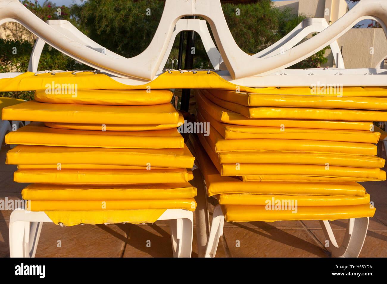 yellow sun bed mattresses - Stock Image