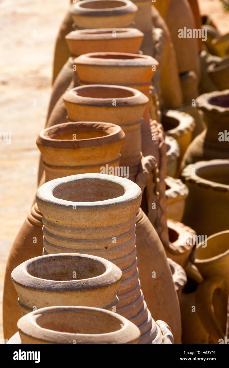 Row of tall narrow necked clay pots - Stock Image