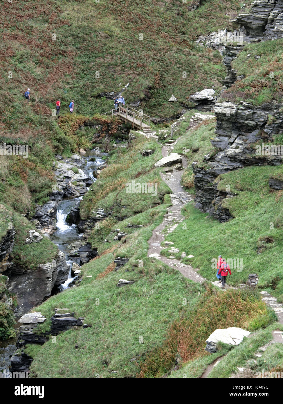 Walkers at Rocky Valley, St Nectan's Glen, Cornwall, England, UK - Stock Image
