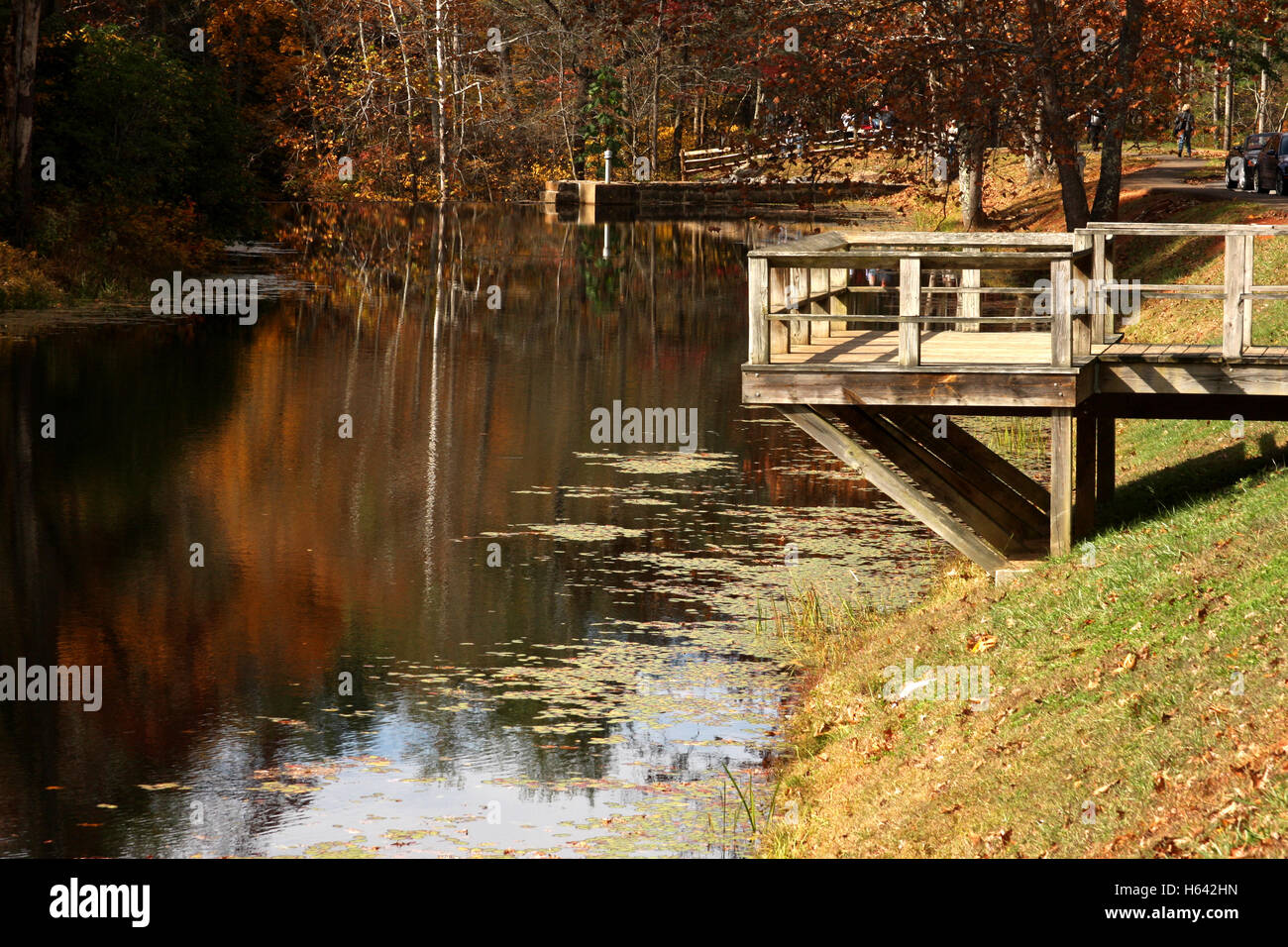 Decks at small lake in autumn - Stock Image