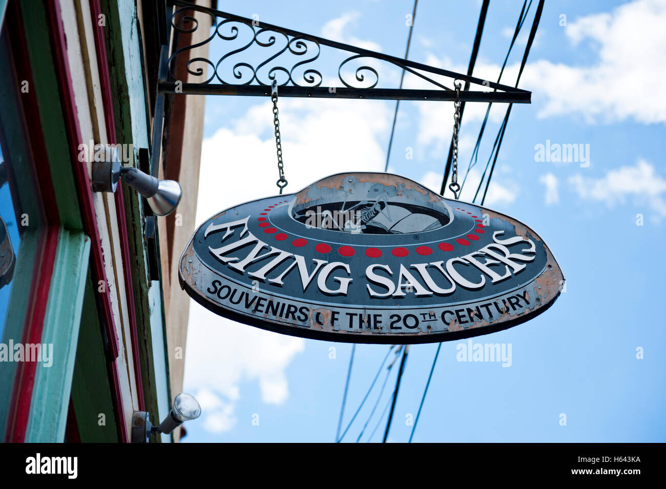 The front sign for Flying Saucers a retail shop in historic Bisbee Arizona - Stock Image