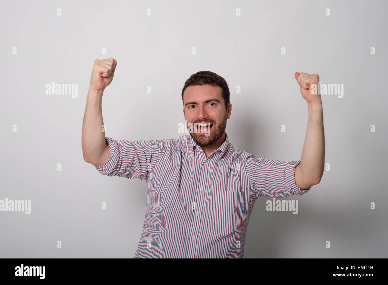 Man very happy for a victory - Stock Image