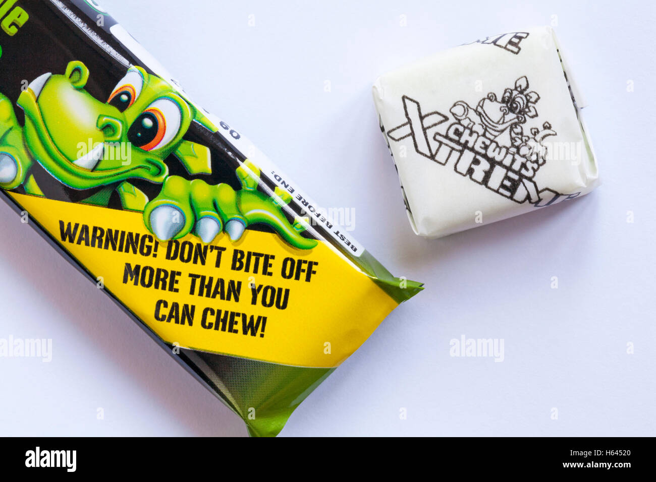 Warning don't bite off more than you can chew - detail on pack of Extreme Chewits extremely sour apple with - Stock Image