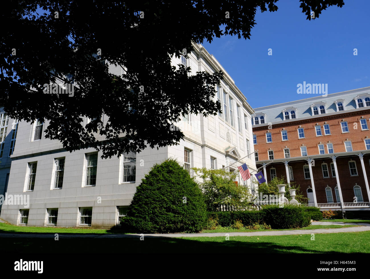 Classically designed US courthouse and justice department showing a half-mast US flag at the entrance. - Stock Image