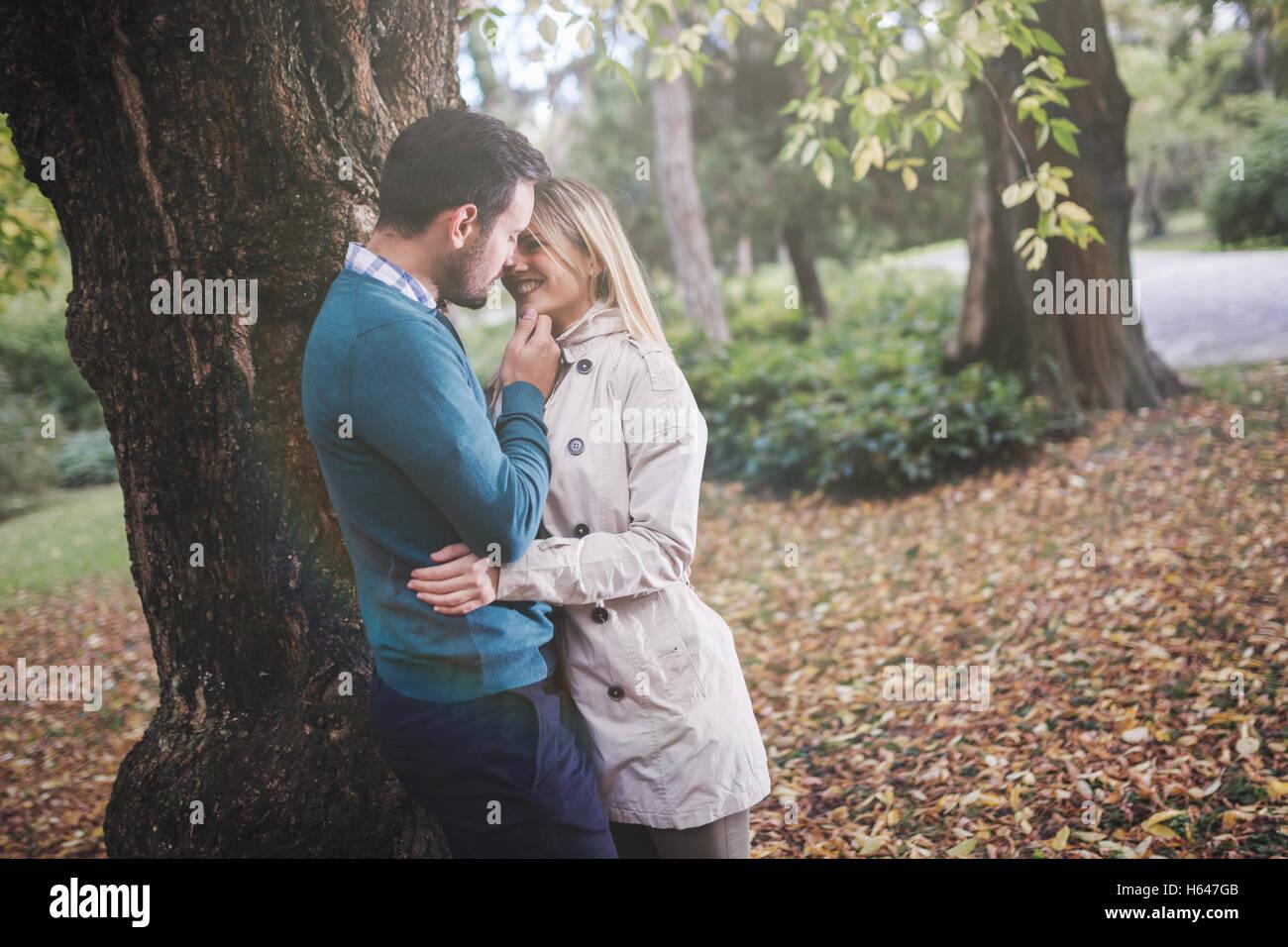 Loving happy couple walking in park - Stock Image