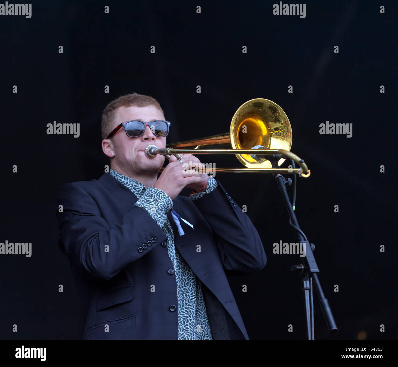 Lucas Petter, trombonist, with Chainska Brassika, on the main stage at the On Blackheath Music Festival 2015 - Stock Image