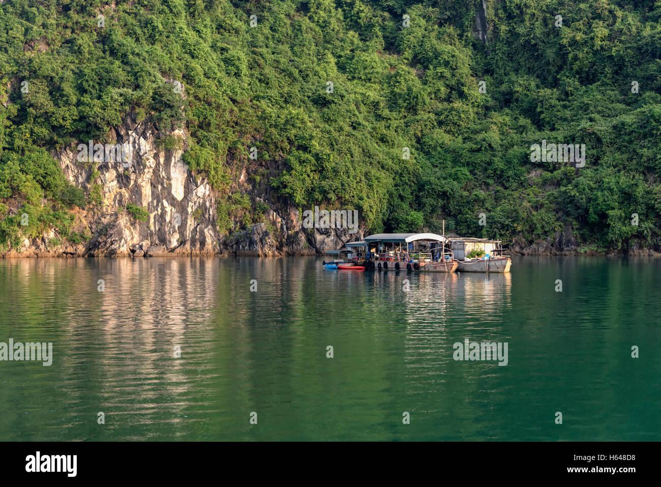 Boat houses in Ha Long Bay - Stock Image