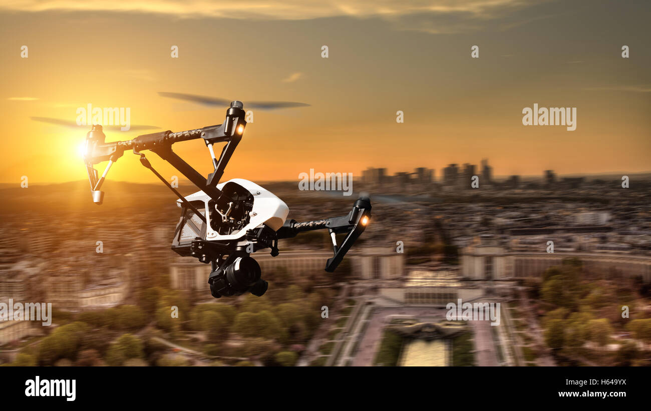 Drone flying above Paris city panorama in blur motion - Stock Image