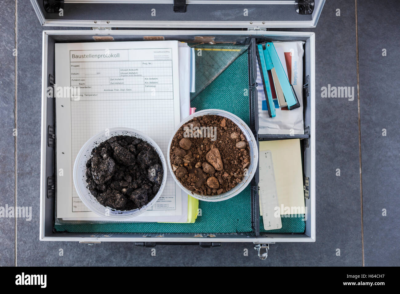 Case of geotechnical expert with soil samples and documents - Stock Image