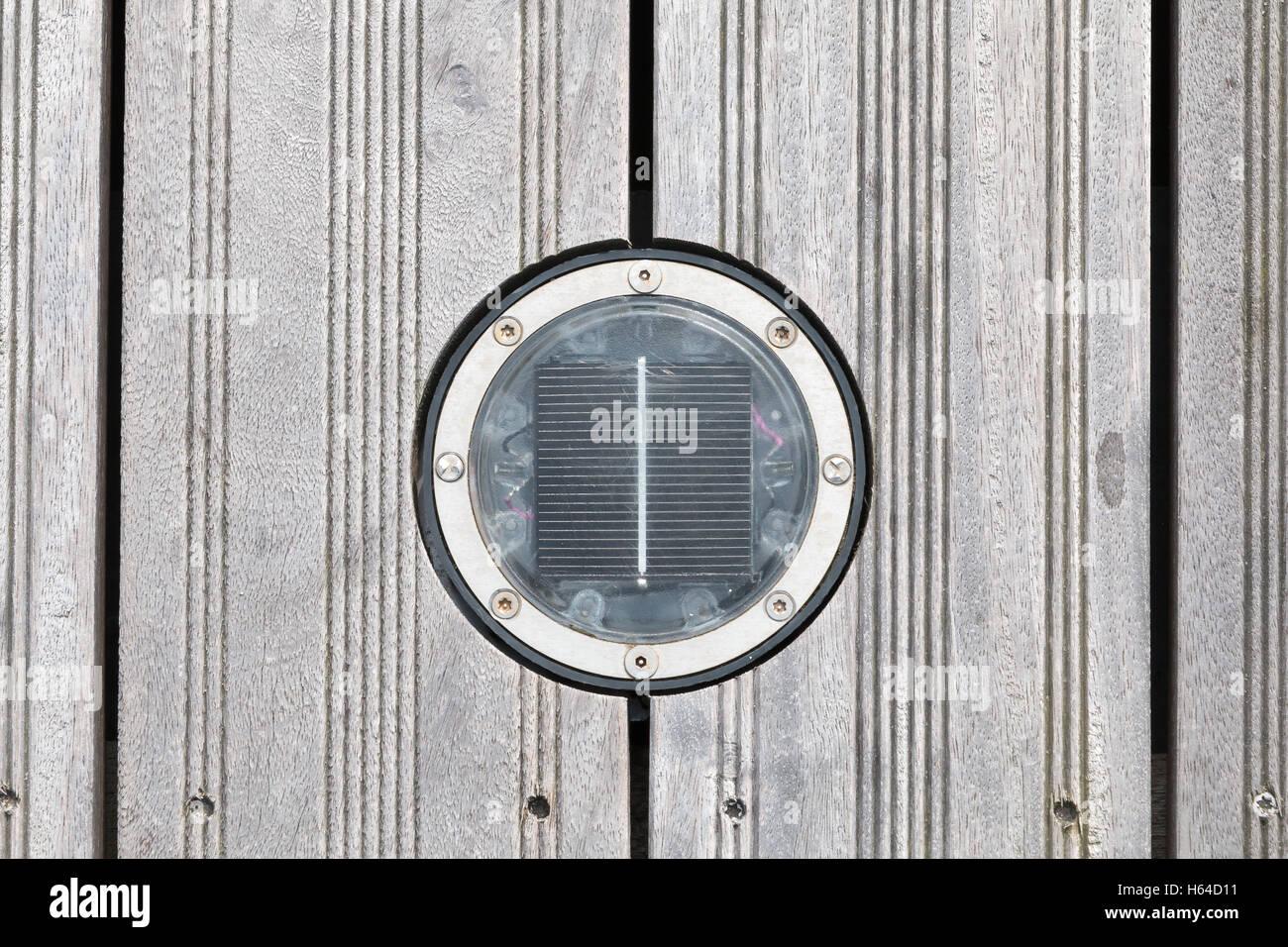 Solar Round Deck light LED on a wooden bridge - Stock Image