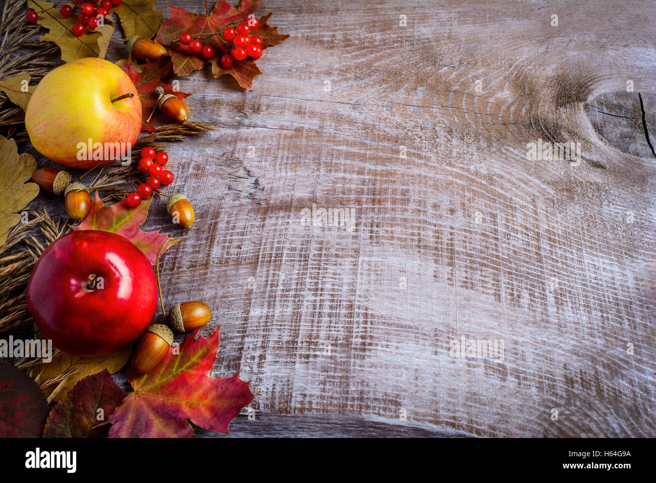 Border Of Apples Red Berries And Fall Leaves On The Rustic Wooden Background Thanksgiving With Seasonal