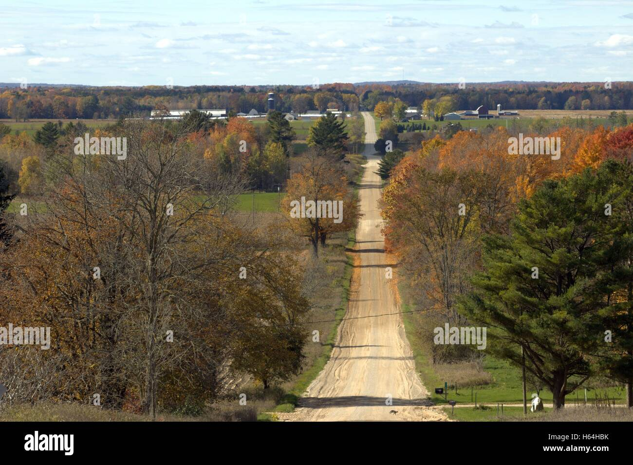 Looking West Down The Dirt Road From 7 Mile Hill in Autumn, Missaukee County, Michigan - Stock Image