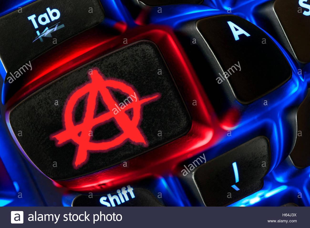 Anarchy emoji shown on a backlit keyboard, Dorset, England, UK - Stock Image