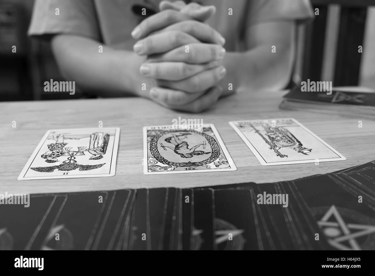 Fortune teller a tarot card monochrome effect. - Stock Image