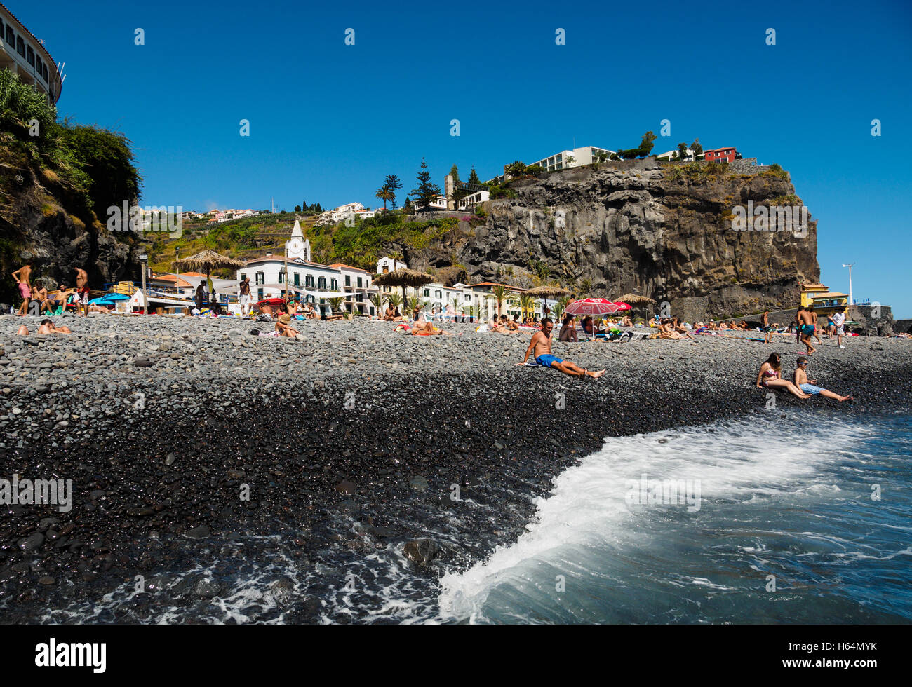 The beach of Ponta do Sol with the Enotel hotel on the Portuguese island of Madeira - Stock Image