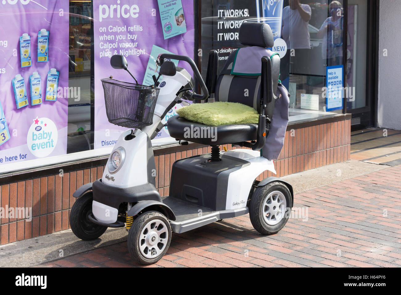 Galaxy Plus mobility scooter outside Boots store, High Street, Sittingbourne, Kent, England, United Kingdom - Stock Image