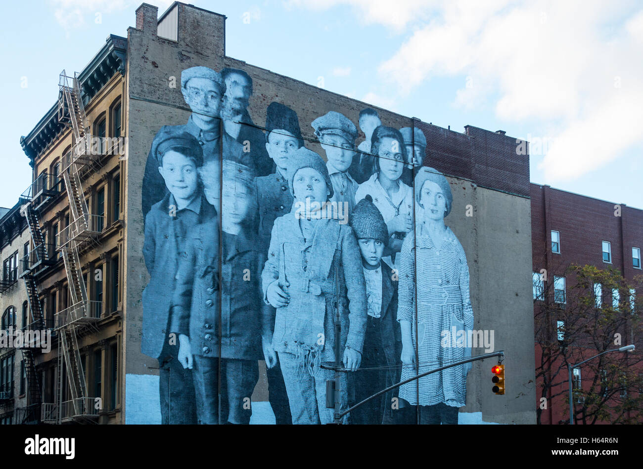 Large wall mural of Ellis Island immigrants in New York City Stock