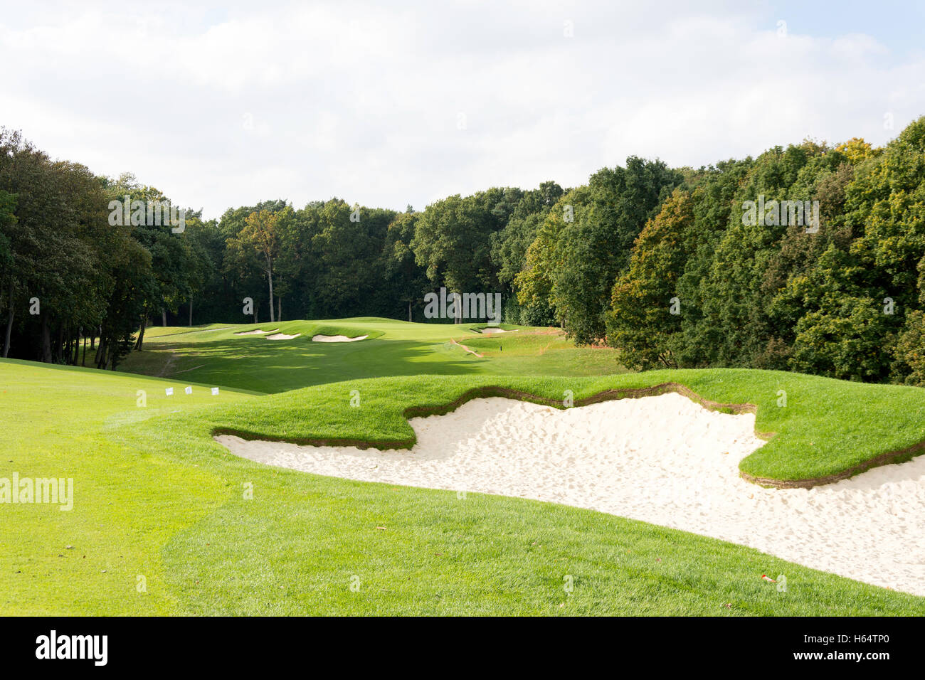 Golfing fairway and bunkers at The Wentworth Golf Club & Health Resort, Virginia Water, Surrey, England, United - Stock Image