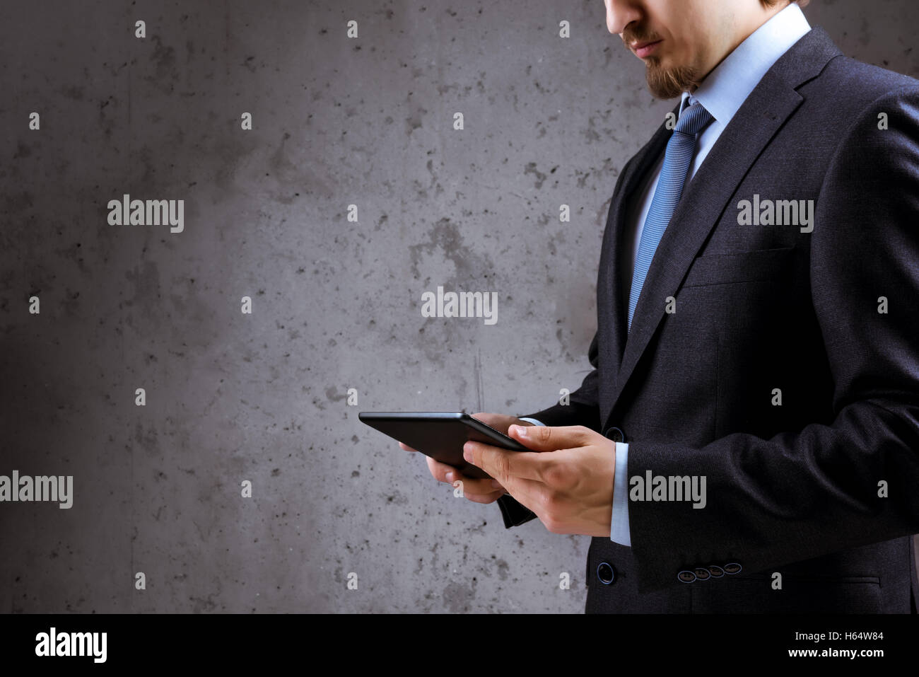 Business man tablet pc concept - Stock Image