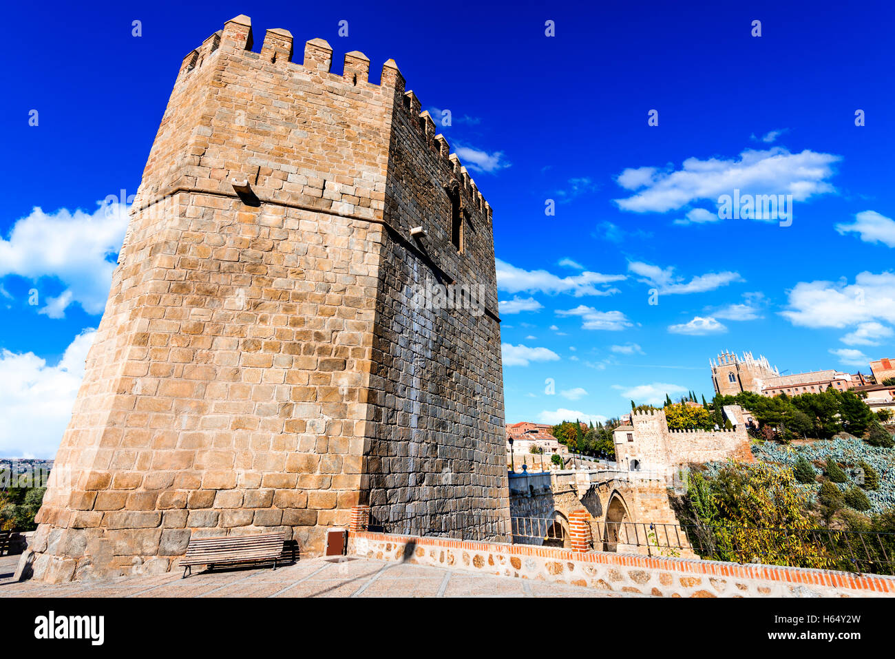 Toledo, Spain.  San Martin stone bridge across calm river. Popular tourist place in Europe. - Stock Image