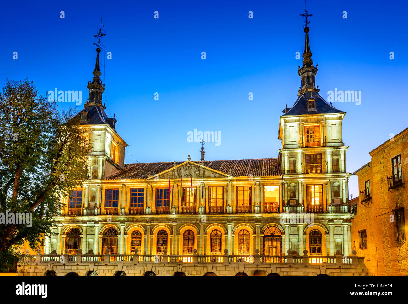 Toledo, Spain. Evening light at Plaza del Ayuntamiento in front of the Cathedral of Saint Mary. - Stock Image