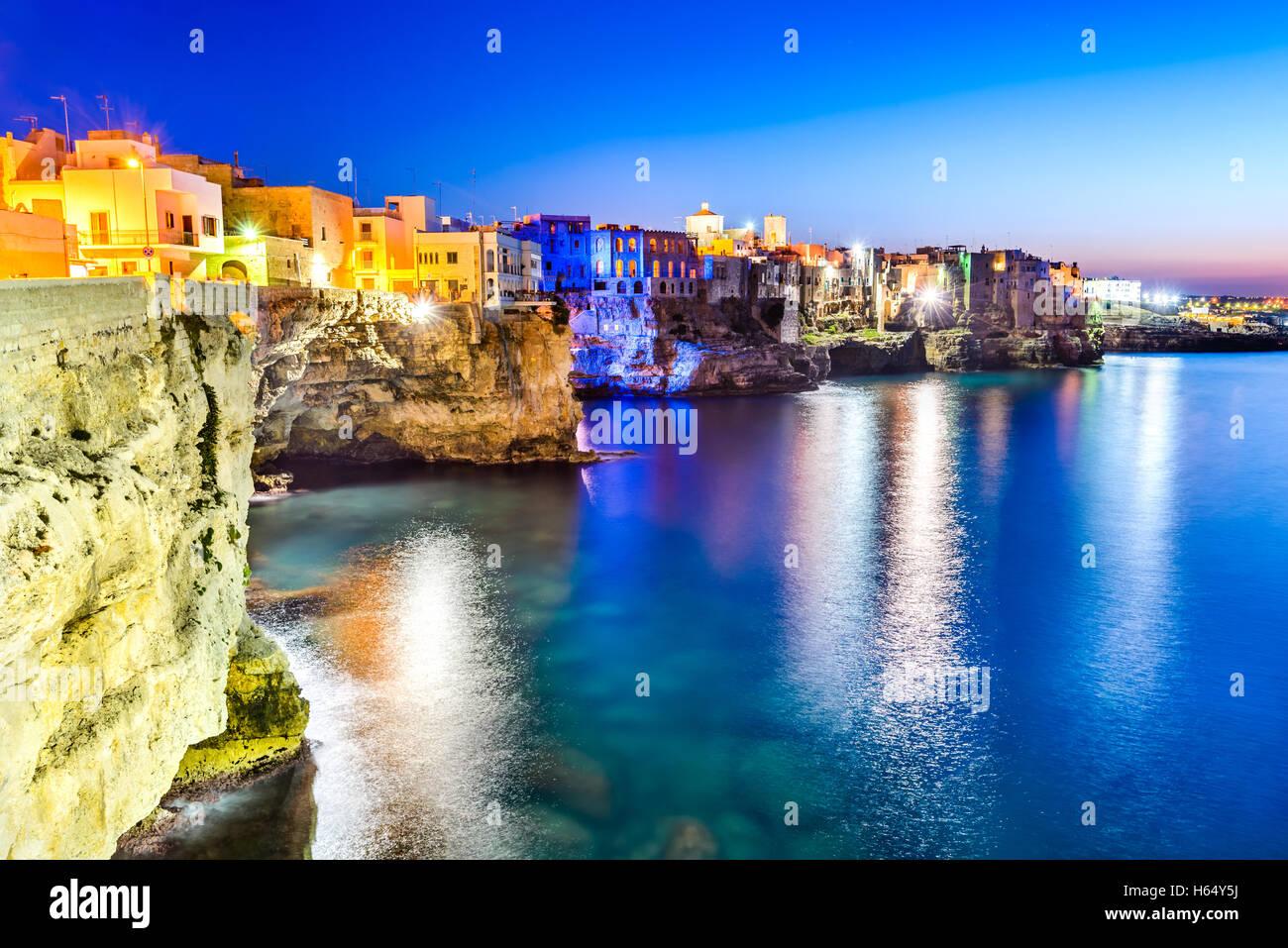 Puglia, Italy. Sunset scenery of Polignano a Mare, town in the province of Bari, Apulia, southern Italia on the - Stock Image