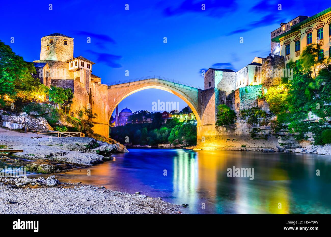 Mostar, Bosnia and Herzegovina. The Old Bridge, Stari Most, with emerald river Neretva. - Stock Image