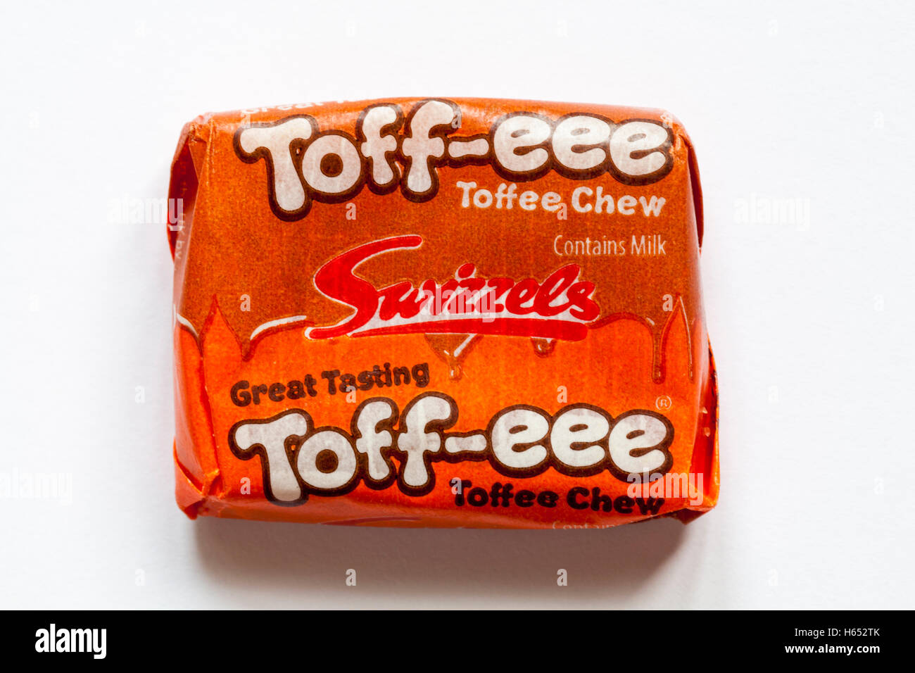 Swizzels great tasting toff-eee toffee chew sweet isolated on white background - chews sweets candies candy - Stock Image