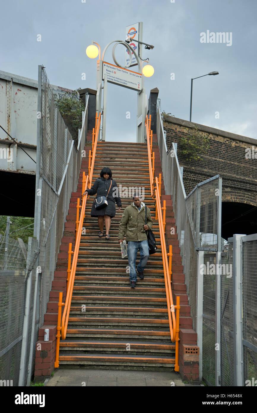 Passengers at Willesden Junction Overground train station. London.UK - Stock Image