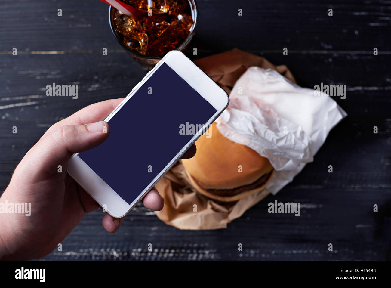 Cheeseburger with moblie phone Stock Photo