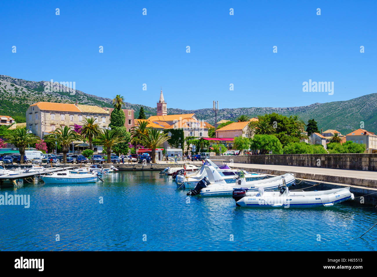 Orebic, CROATIA - JUNE 25, 2015: Scene of the port, and the town center, with locals and tourists, in Orebic, Croatia - Stock Image