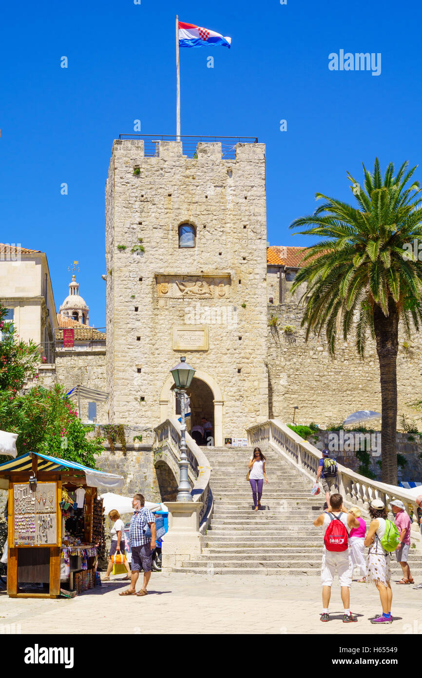 KORCULA, CROATIA - JUNE 25, 2015: Scene of the main (land) gate of the old town, with souvenirs sell stand, locals - Stock Image