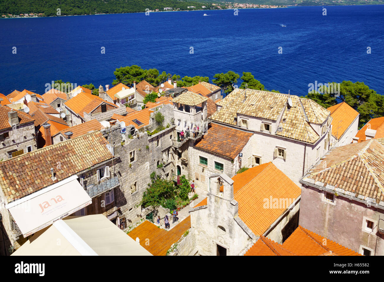 KORCULA, CROATIA - JUNE 25, 2015: Rooftop view of the old town, with the House of Maco Polo, locals and visitors, - Stock Image