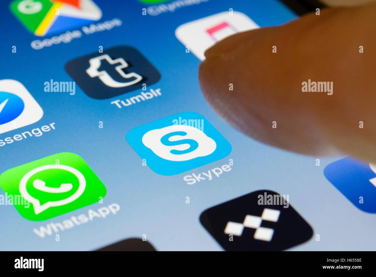 Skype online internet calling app close up on iPhone smart phone screen - Stock Image