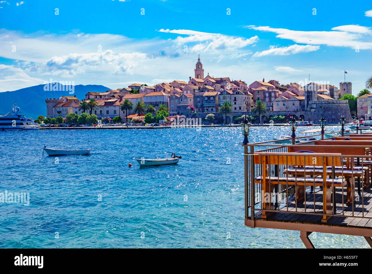 KORCULA, CROATIA - JUNE 26, 2015: Scene in the old town (west side), with the walls, houses, boats, locals and visitors, - Stock Image