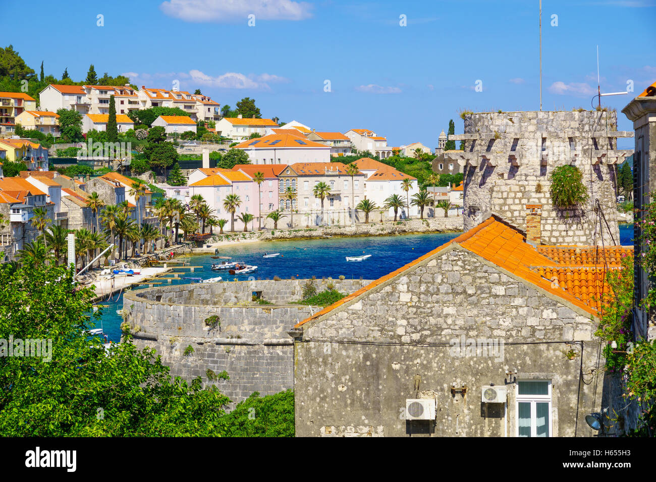 KORCULA, CROATIA - JUNE 26, 2015: Scene of the old town, with The Small Governor Tower, the bay, boats, locals and - Stock Image