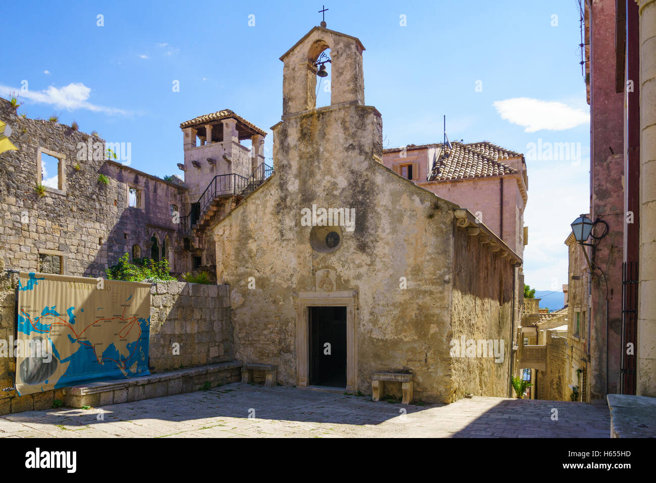 KORCULA, CROATIA - JUNE 26, 2015: The Saint Peter church and a map of the voyages of Marco Polo, in the old town - Stock Image