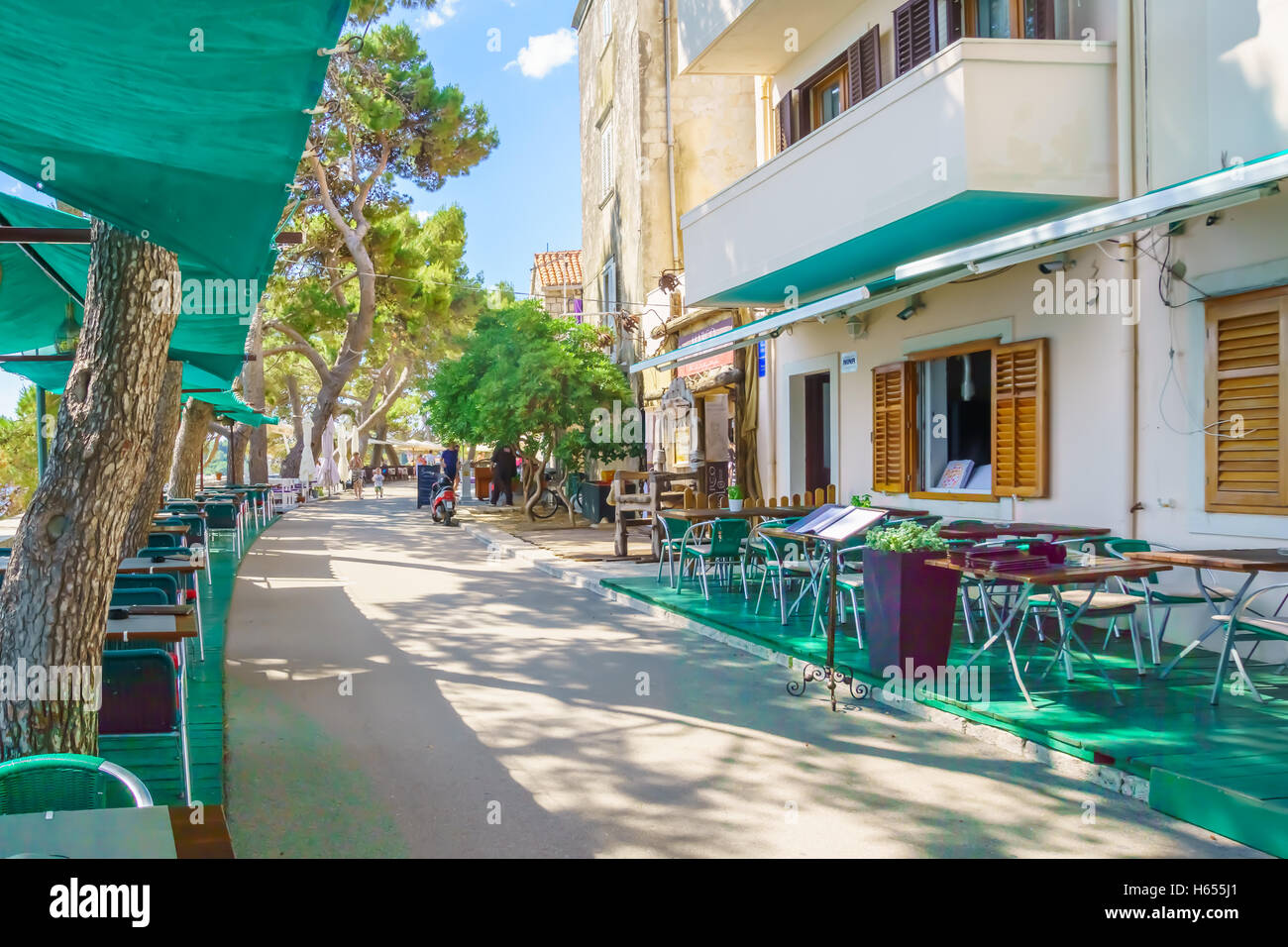 KORCULA, CROATIA - JUNE 26, 2015: Cafe scene, with local businesses, locals and visitors, in the old town of Korcula, - Stock Image