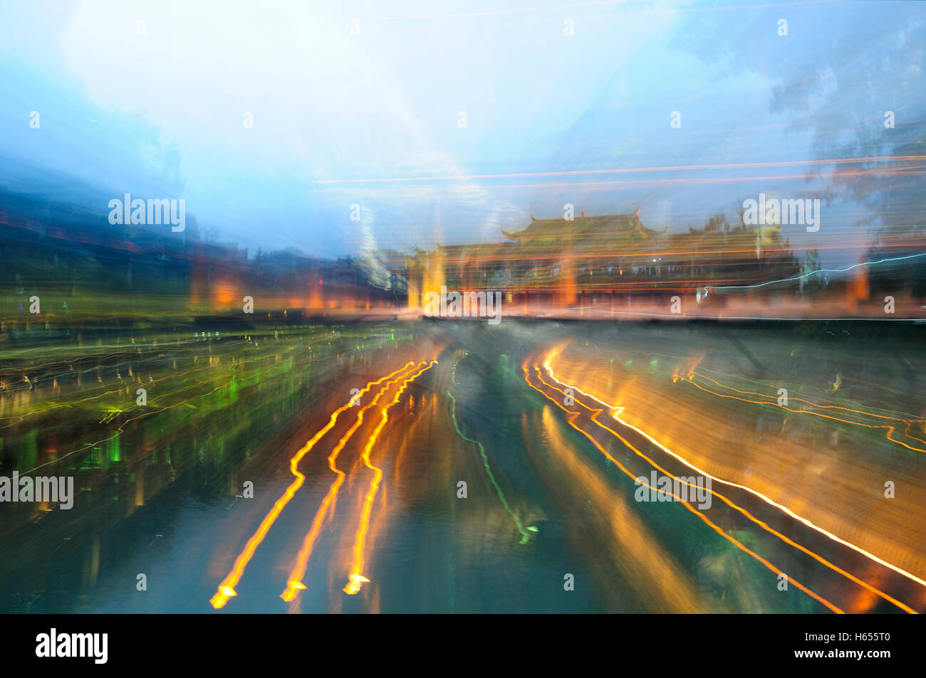 An abstract image of the Hongqiao landmark with blurred lights in the village of Fenghuang in Hunan Province China. - Stock Image