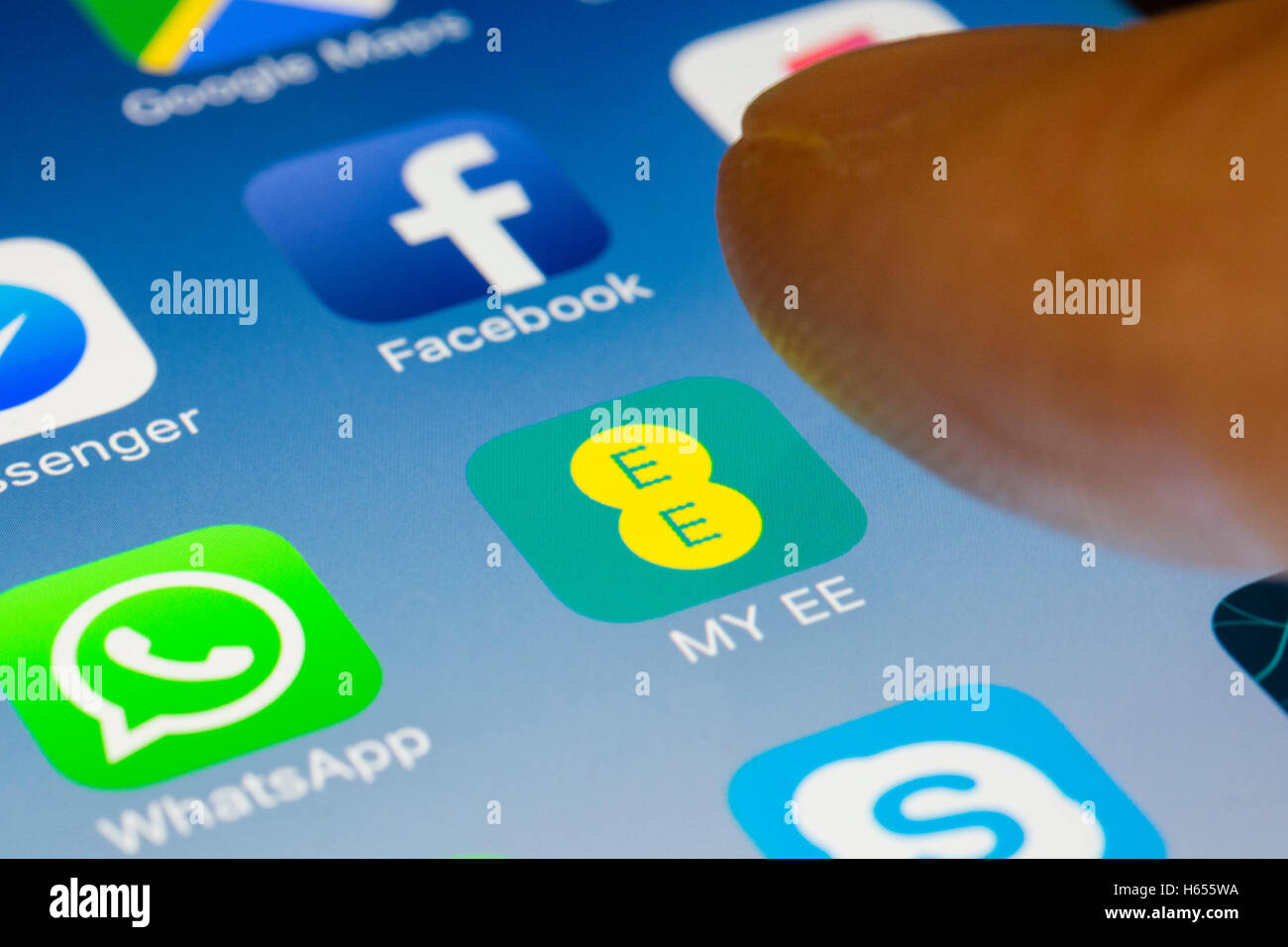 My EE mobile phone network provider online app close up on iPhone smart phone screen Stock Photo