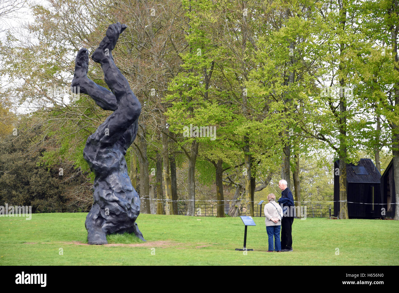 Visitors viewing Scupture by David Breuer-Weil's in Mottisfont gardens - Stock Image