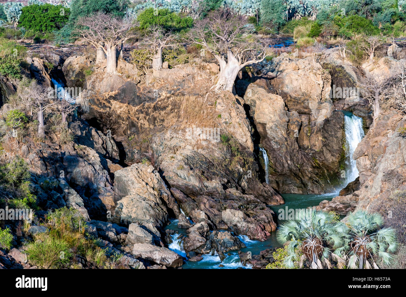 View of Epupa falls on the border of Namibia and Angola. The falls are created by the Kunene River in the Kaokoland - Stock Image