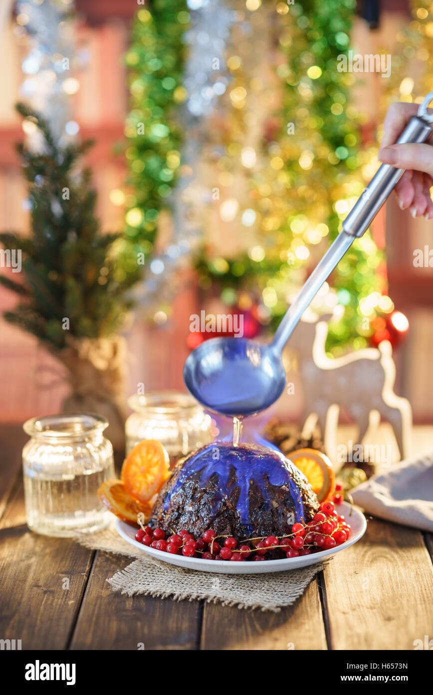 Christmas pudding flambe - Stock Image
