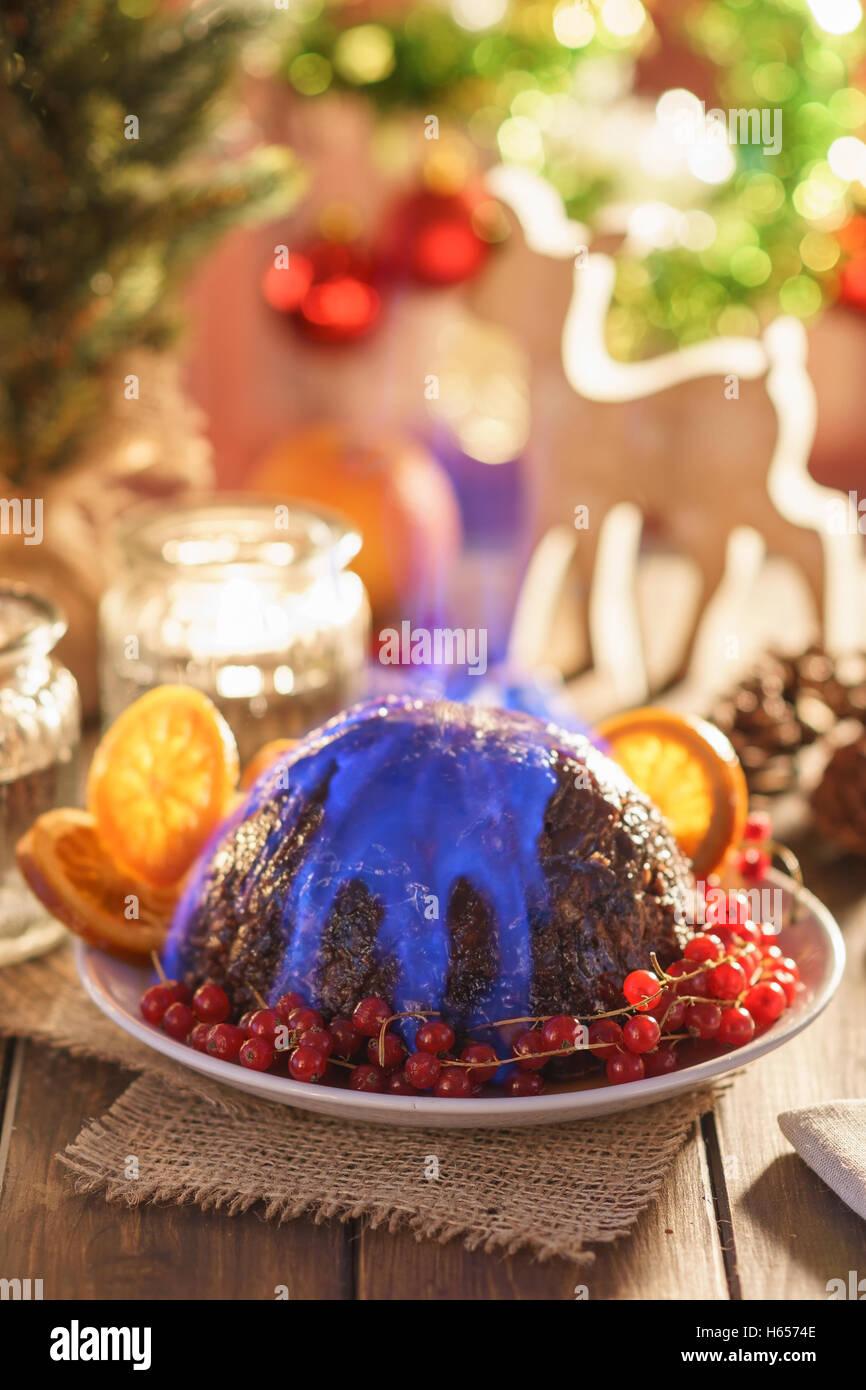 Christmas pudding flambe - Stock Image