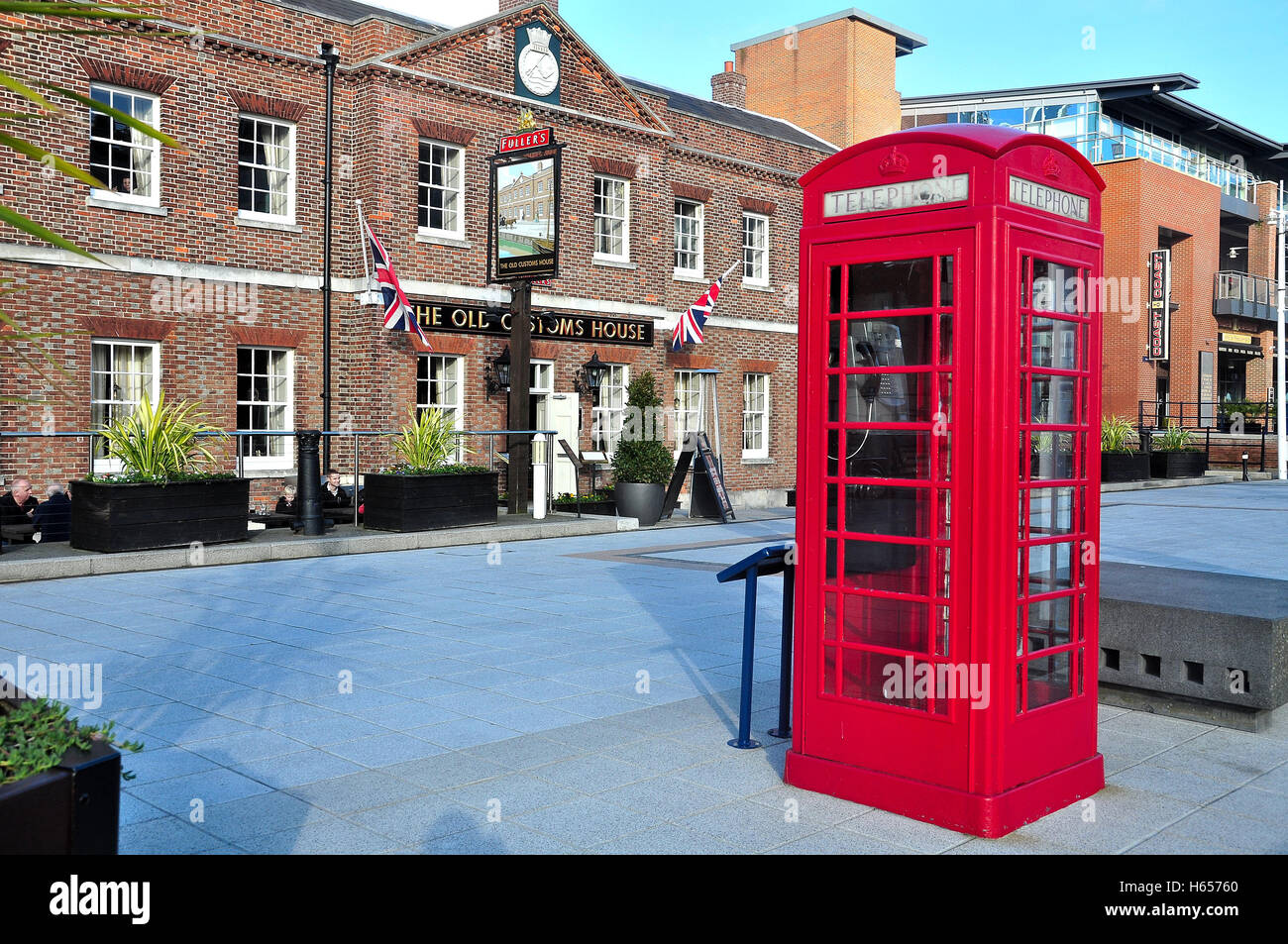 The Old Customs House Pub and telephone box at Gunwharf Quays, Portsmouth Harbour, Portsmouth, Hampshire, England, - Stock Image