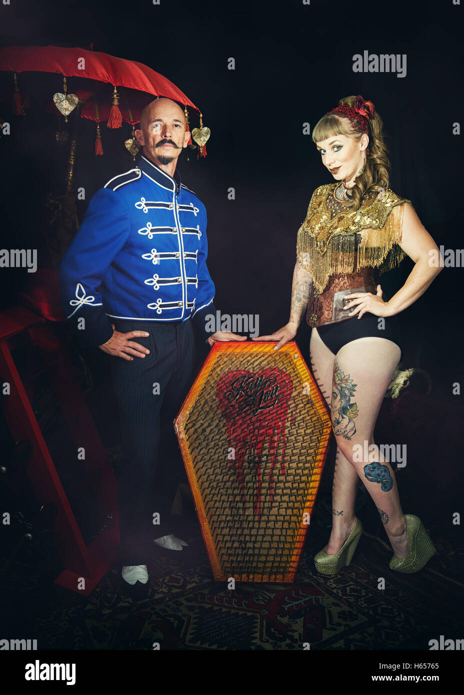 Circus performers with a bed of nails Stock Photo