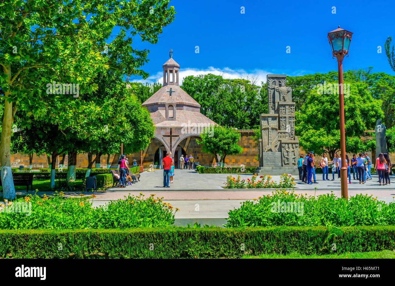 The St Vartan nad Hovhannes Baptistery and the Genocide Monument, surrounded by lush garden, Vagharshapat, Armenia - Stock Image